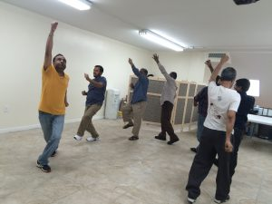 Diabetes management class participants perform group exercises.
