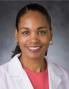 Photo of Dr. L. Ebony Boulware in a labcoat