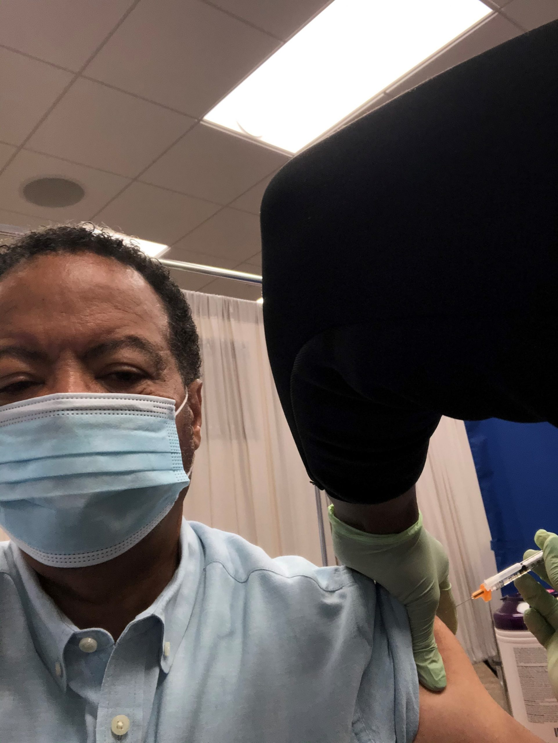 Photo of Dr. Roderic I. Pettigrew getting a COVID-19 vaccine
