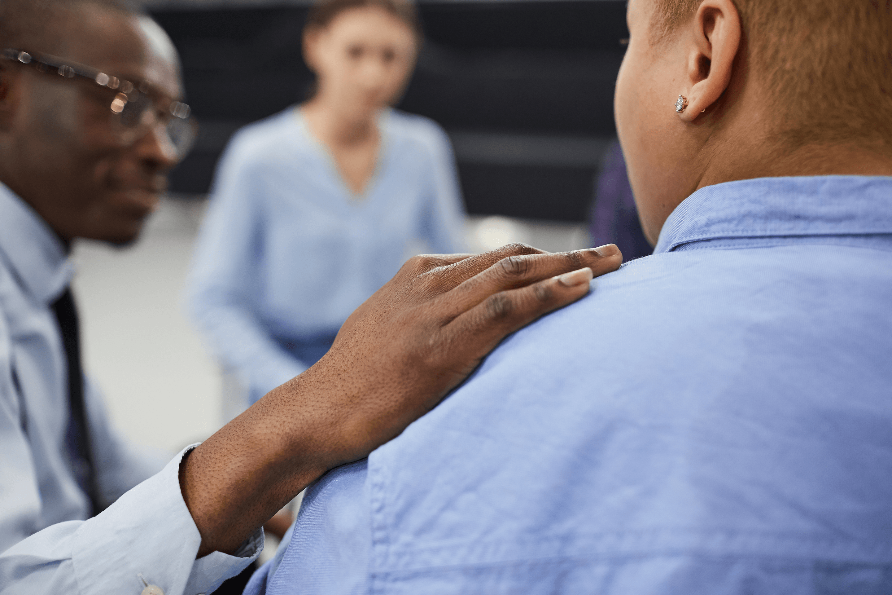 stock image of minorities in counseling circle